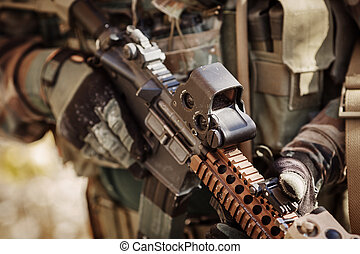 solder in gloves holding assault automatic rifle - ranger in...