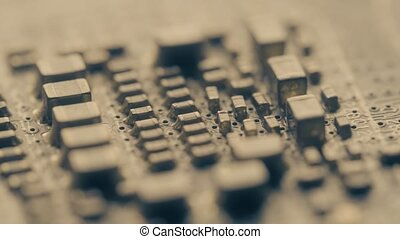 Soldered computer circuit board components, macro video -...