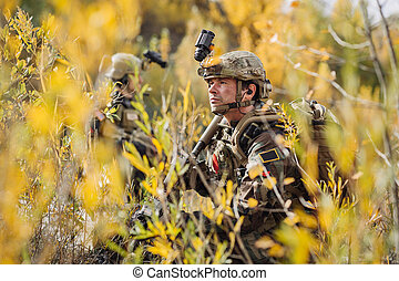 solders standing and looking at the camera
