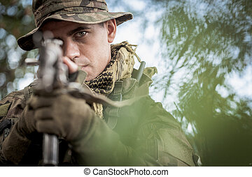 Soldier aiming from weapon