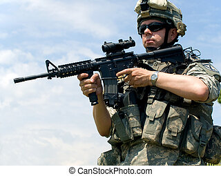 Soldier aiming his rifle - Soldier in camouflage uniform...