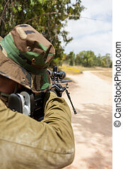 soldier aiming with a sniper rifle