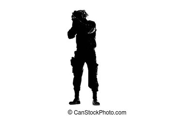 Soldier armed. Silhouette - Soldier armed, a man in...