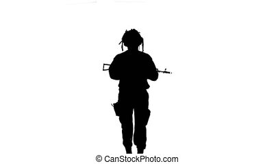 Soldier comes with weapons. Silhouette - Soldier comes with...