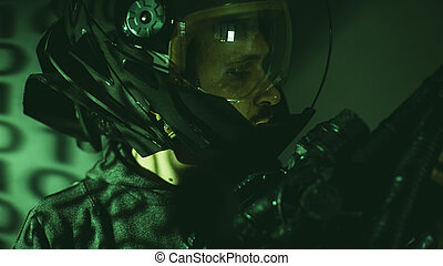 Soldier, cyborg man of the future with helmet lights led and huge laser gun
