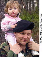 American Army soldier holding baby on his shoulders