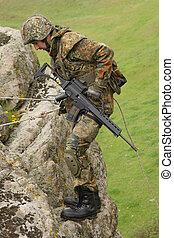 Soldier does alpinism - Military man does dangerous ...