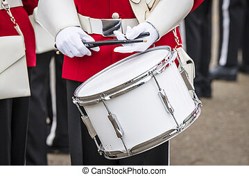 Soldier drummer in red uniform