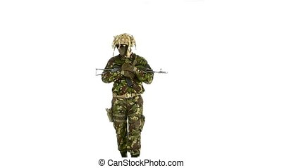 Soldier goes and holds the weapon in his hands. White...