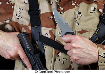 Soldier holding knife in ready position