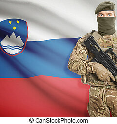 Soldier holding machine gun with flag on background series...