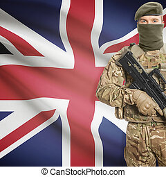 Soldier holding machine gun with flag on background series - United Kingdom