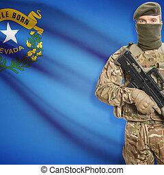 Soldier holding machine gun with USA state flag on background - Nevada
