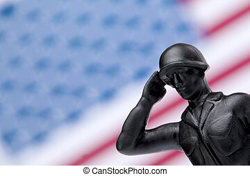 soldier honoring the american flag