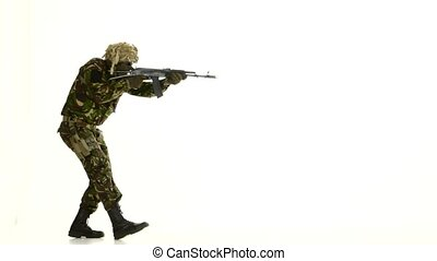 Soldier in camouflage clothing and armed. White backgraund -...