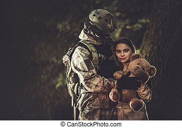 Soldier in Camouflage Return From Mission and Meeting His Daughter