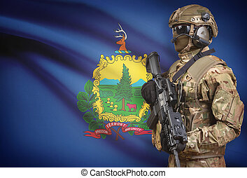 Soldier in helmet holding machine gun with USA state flag on background series - Vermont