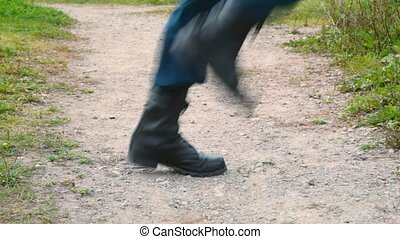 soldier in military boots running on the spot, profile