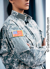 soldier in military uniform with usa emblem