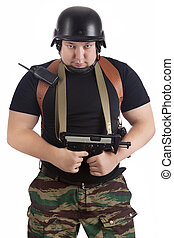 Soldier in the helmet with the rifle
