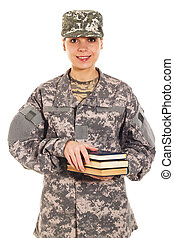 Soldier in the military uniform with books, isolated