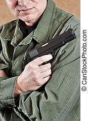 Soldier in uniform holding gun