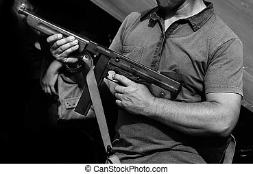 soldier in uniform with a gun in his hand in training camp