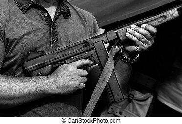 soldier in uniform with a submachine gun