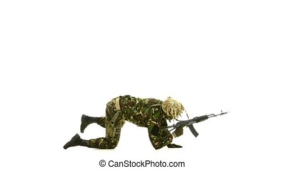 Soldier lay on the floor and took aim towards. White backgraund