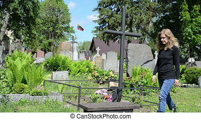 soldier loss girl grave - young girl sit near boyfriend...