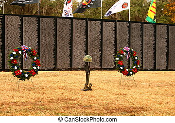 A soldier memorial in front of the traveling Vietnam wall.