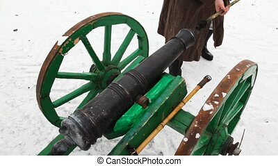 soldier of Russian army 19th century clean cannon with...