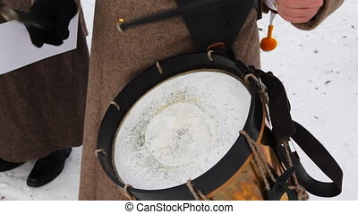 soldier of Russian army 19th century play drums, close-up