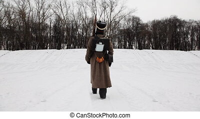 soldier of Russian army 19th century leaves marching snowy winter field
