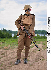 Soldier of WW1 in a gas mask hold a rifle