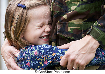 Soldier On Leave Being Hugged By Daughter