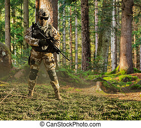 Soldier posing in forest.