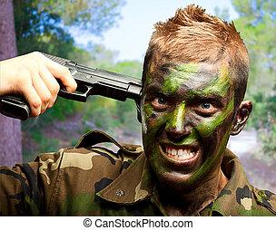 Soldier Putting Gunshot On Head at a park