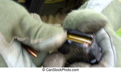 Soldier reload cartridges for weapons - Military charges...