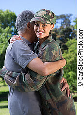 Soldier reunited with her father