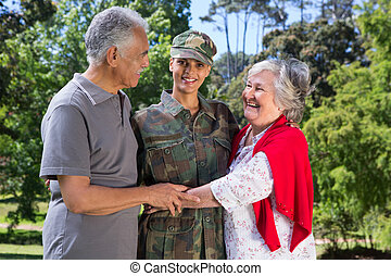 Soldier reunited with her parents