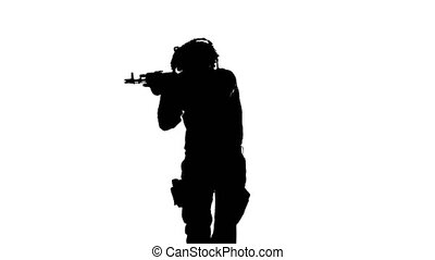 Soldier runs with a gun in his hand. Silhouette - Soldier...