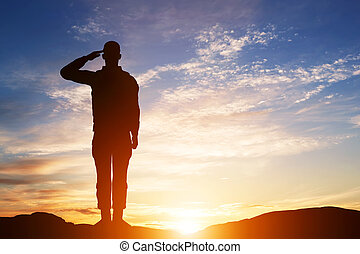 Soldier salute. Silhouette on sunset sky. Army, military. - ...