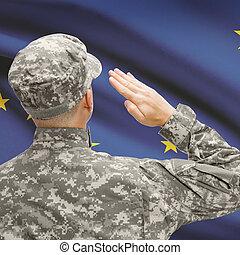 Soldier saluting to US state flag series - Alaska