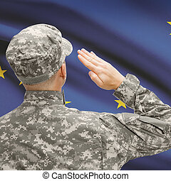 Soldier saluting to US state flag series - Alaska