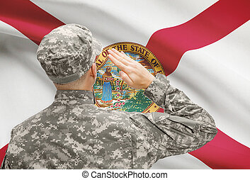 Soldier saluting to US state flag series - Florida