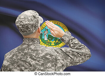 Soldier saluting to US state flag series - Idaho - Soldier...
