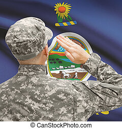 Soldier saluting to US state flag series - Kansas