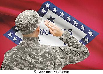 Soldier saluting to US state flag series - Arkansas -...