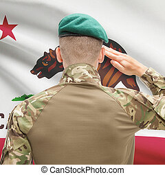 Soldier saluting to USA state flag conceptual series - California